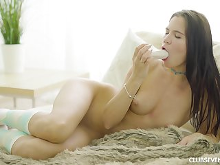 Lovenia Lux spreads her legs so she can play with a dildo