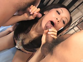 Hot and wild Asian likes to suck two strong dicks at tantamount time