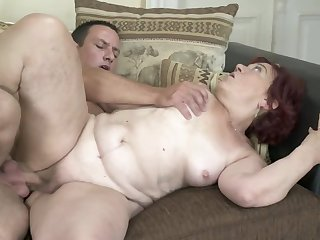 Red-haired granny finally gets her old twat banged hard
