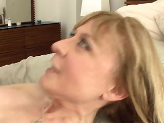 Well-endowed cougar seduces in stockings and a garnishment