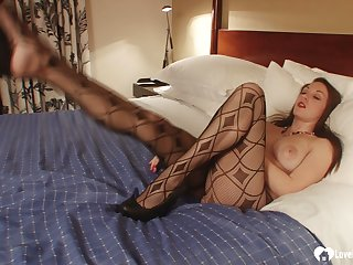 Brunette in pantyhose moans during her solo session