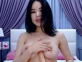 Cute Asian Coquette Masturbating On Her Webcam