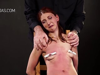 Kinky, red haired babe got tied up to a chair plus forced to suck various sex toys