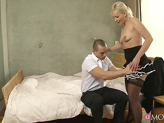 Shaved pussy cougar Melissa Hard undressed and fucked by a stud