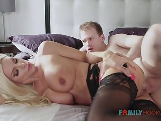 Sizzling blnde COUGAR is wearing softcore, dark-hued stocking while having fuck-a-thon about her spouse's mate